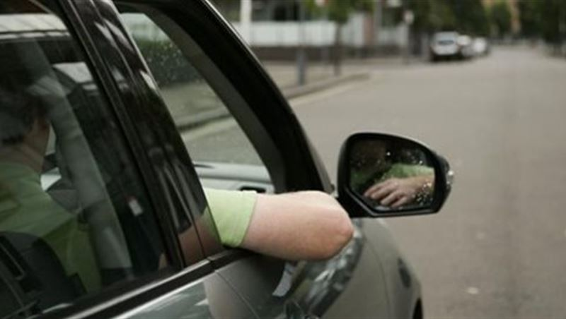 Drivers with Their Hands Hanging Outside the Window